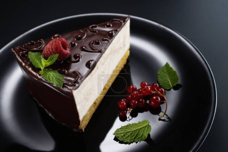 Photo for Chocolate cake with decoration and fruits as background. - Royalty Free Image