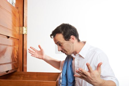 man with empty wardrobe