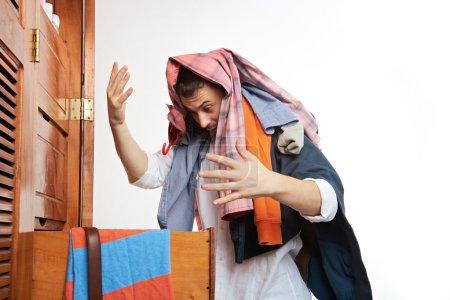 man with his wardrobe