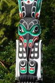 Native people totem pole. Handcrafted representation of unique culture.