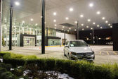 Vancouver BC, Canada - January 9, 2018: Office of official dealer Mercedes-Benz. Mercedes-Benz is a German automobile manufacturer Night shot all sings and inside of the building is illuminated.