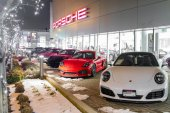Vancouver BC, Canada - January 9, 2018: Porsche is a German automobile manufacturer specializing in high-performance cars. Porsche cars in front of car dealership, luxury fast and expensive cars. Nigh