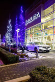 Vancouver BC, Canada - January 9, 2018: Acura automobile dealership store front. Acura is the luxury vehicle division of Japanese automaker Honda. Night shot all sings and inside of the building is il