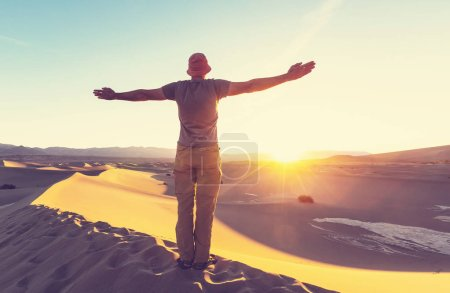 Hiker in sand desert