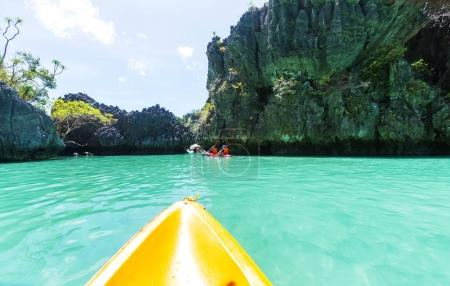 Kayak in the island lagoon between mountains.