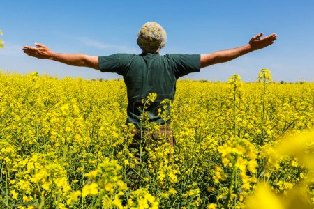 Happy man in the yellow field