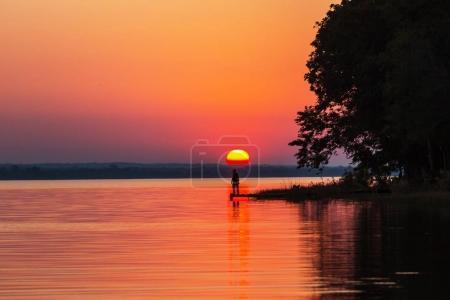Photo for Sunset scene at the lake Peten Itza, Guatemala. Central America. - Royalty Free Image