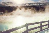 Wooden boardwalk along geyser fields  in Yellowstone National Park, USA
