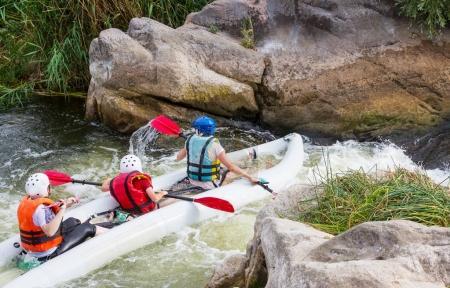 Kayaking in mountain river leisure activity