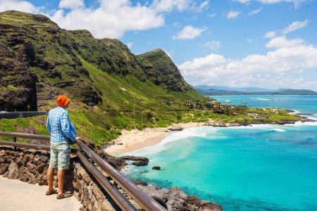 man looking at Beautiful landscapes in Oahu island, Hawaii