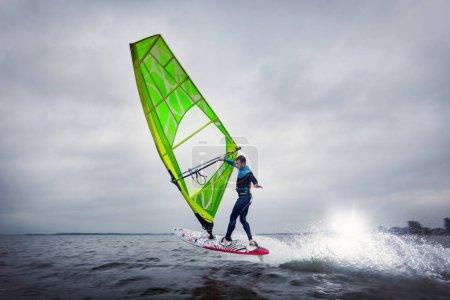 Professional windsurfer jumping