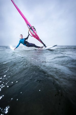 Windsurfer hanging in wind