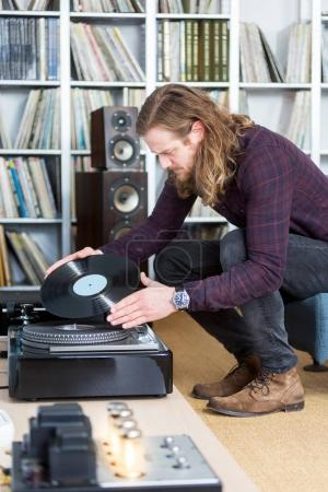 man looking on vinyl