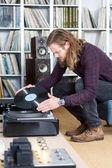 man looking on vinyl