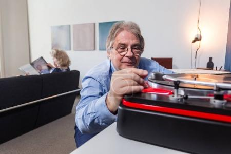 man placing needle on vinyl