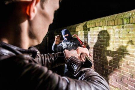 Police Pointing Gun Towards Cracksman