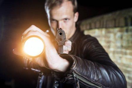 officer holding flash light