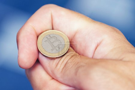 Photo for Businessman hand tossing bitcoin, concept of chance, opportunity and decision making - Royalty Free Image