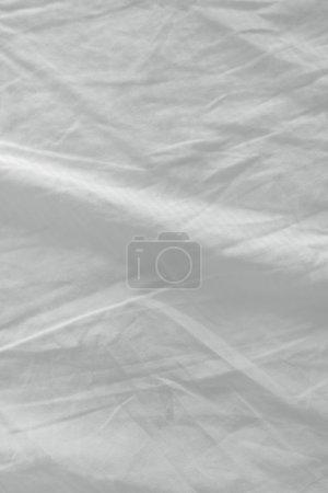Photo pour Texture des draps de lit usagés, surface en coton froissé blanc propre - image libre de droit
