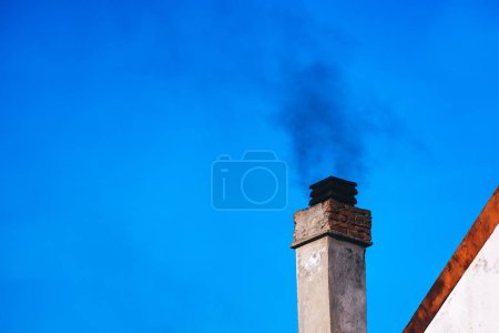 Smoke from house chimney
