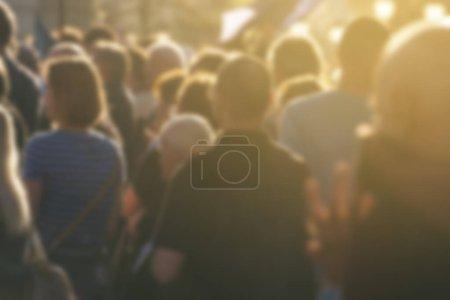 Defocused crowd attending political meeting