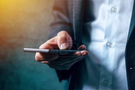 Photo for Hand with mobile phone texting, businessman sending sms message on smartphone - Royalty Free Image