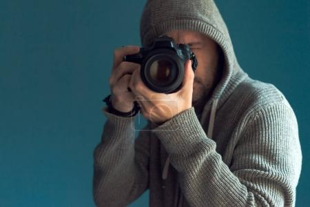 Photo for Photographer holding full frame sensor DSLR camera and taking pictures - Royalty Free Image