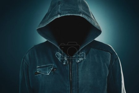 Mysterious suspicious faceless man with hoodie, da...