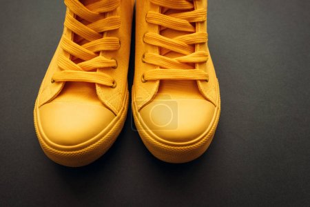 Photo for Stylish yellow sneakers on gray background with copy space - Royalty Free Image