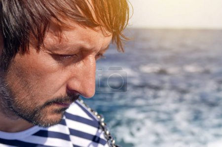 Photo for Man looking at the sea from yacht while sailing on his summer vacation holiday - Royalty Free Image