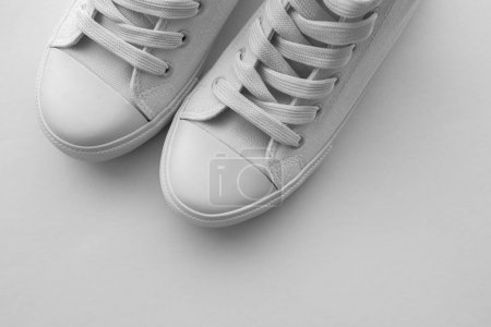 Photo for Pair of white sneakers with copy space, modern casual canvas shoes - Royalty Free Image