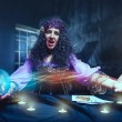 Angry sorceress working with crystal ball. Crazy s...
