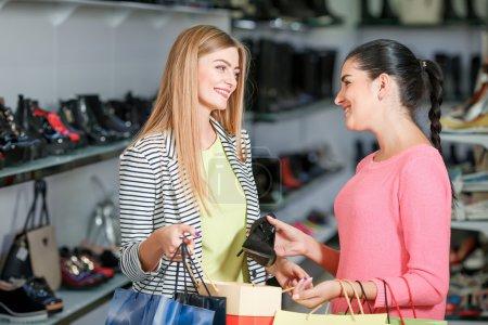 women shopping in shoe store
