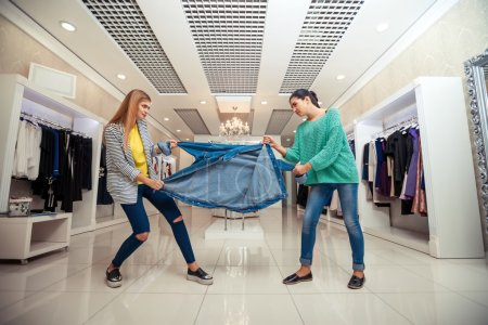 Young women fighting for jacket