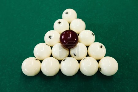 Cue balls on green table