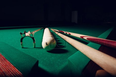 Billiard equipment on table