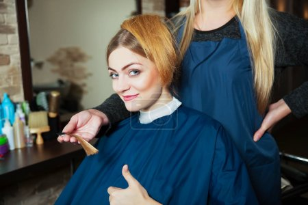 Beautiful woman happy with hair color