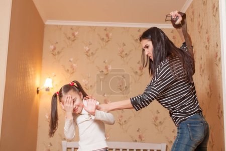 mother trying to hit daughter with belt