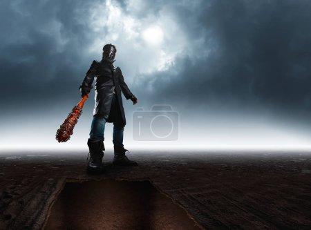 Bloody maniac in hockey mask with bat