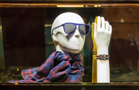 mannequin head in sunglasses and scarf