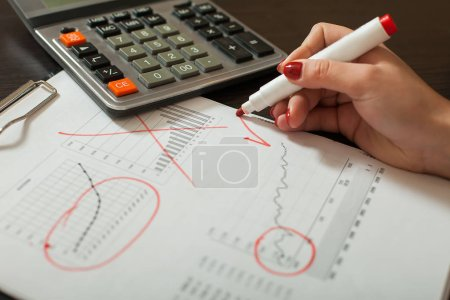 bookkeeper working with balance sheet
