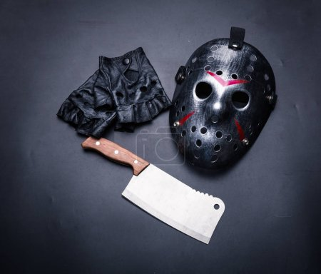 mask with leather gloves and meat cleaver