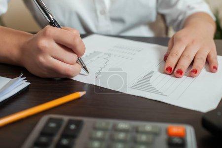 bookkeeper signing balance sheet