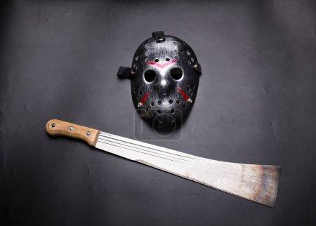 Metal mask and machete