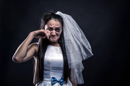 Tearful bride in white dress
