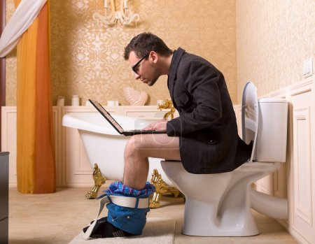 Man on toilet bowl