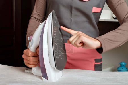 woman in cleaning service uniform