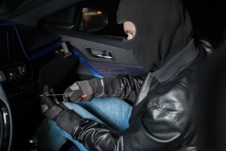 carjacker unlocking glove box