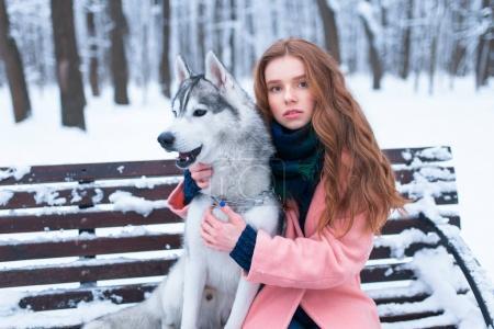 young woman and siberian husky dog