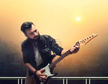male bearded guitarist